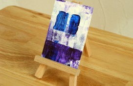 Acrylic miniature painting in blue and purple paint