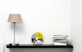 Yellow and Black Abstract Art on Sheldf with Lamp and Books