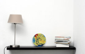 Portholes of Aurelia XX Lamp and Books on Shelf view